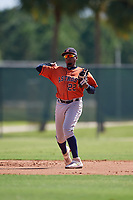 GCL Astros shortstop Yorbin Ceuta (22) throws to first base during a Gulf Coast League game against the GCL Marlins on August 8, 2019 at the Roger Dean Chevrolet Stadium Complex in Jupiter, Florida.  GCL Astros defeated GCL Marlins 4-2.  (Mike Janes/Four Seam Images)