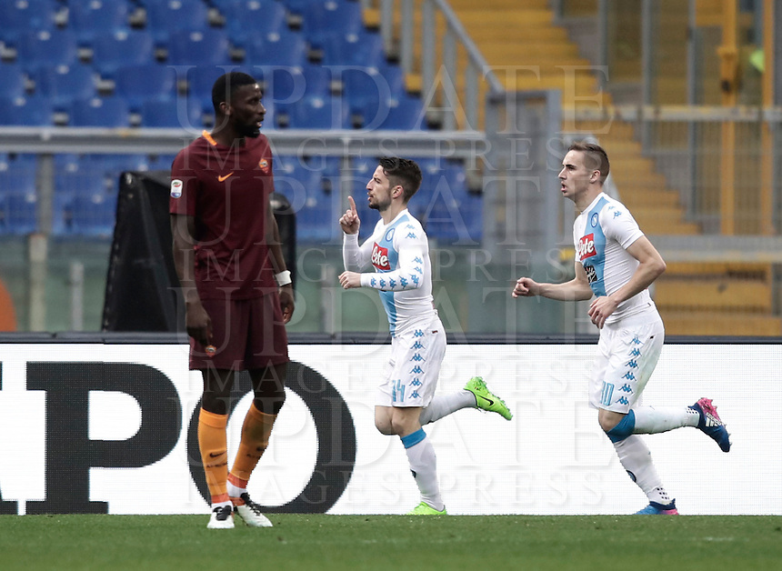 Napoli's Dries Mertens, center, celebrates with his teammate Marko Rog, right, as Roma's Antonio Ruediger reacts after scoring during the Serie A soccer match between Roma and Napoli at the Olympic stadium, 4 March 2017.<br /> UPDATE IMAGES PRESS/Isabella Bonotto