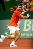 10-2-06, Netherlands, tennis, Amsterdam, Daviscup.Netherlands Russia, Raemon Sluiter in action against Dmitry Tursonov