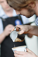 MELBOURNE, 13 April 2014 - Ben Morrow from Victoria competing in the AASCA Australian Latte Art Championship held at 16 River Street, Richmond, Victoria. Photo Sydney Low.