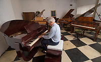 BNPS.co.uk (01202) 558833<br /> Pic: ZacharyCulpin/BNPS<br /> <br /> Pictured: David Winstontries out the keys<br /> <br /> A remarkable collection of rare pianos belonging to the Queen's personal restorer and conservator has emerged for sale for £250,000.<br /> <br /> David Winston is parting with 26 pianos he has amassed over the past 30 years dating from the 18th century to the present day.<br /> <br /> Mr Winston, who was awarded the Royal Warrant in 2012, is regarded as one of the foremost experts in his field and has restored pianos owned and played by Beethoven, Chopin and Liszt.<br /> <br /> His collection includes a 1925 Pleyel grand piano fitted with an original 'Auto Pleyela' self-playing mechanism in a spectacular Chinoiserie Louis XV case valued at 60,000.