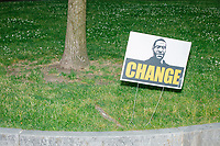 """A sign reading """"Change"""" and featuring a picture of George Floyd stands in Boston Common in Boston, Massachusetts, on Sun., June 7, 2020. George Floyd is a Minneapolis man who was killed by police on May 25, 2020, and whose death has led to weeks of nationwide protests against police brutality."""
