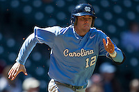 North Carolina Tar Heels shortstop Landon Lassiter #12 runs to first base against the California Golden Bears in the NCAA baseball game on March 2nd, 2013 at Minute Maid Park in Houston, Texas. North Carolina defeated Cal 11-5. (Andrew Woolley/Four Seam Images)