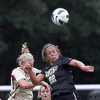 Boston College midfielder Jana Jeffrey (12) and University of Central Florida midfielder Madison Barney (22) battle for head ball. After two overtime periods, Boston College tied University of Central Florida, 2-2, at Newton Campus Field, September 9, 2012.