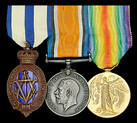 The bravery medal of a 'donkeyman' who saved a sailor from being crushed between two ships.