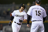 Daniel Palka (7) of the Charlotte Knights rounds third base after hitting a home run against the Rochester Red Wings at BB&T BallPark on May 14, 2019 in Charlotte, North Carolina. The Knights defeated the Red Wings 13-7. (Brian Westerholt/Four Seam Images)
