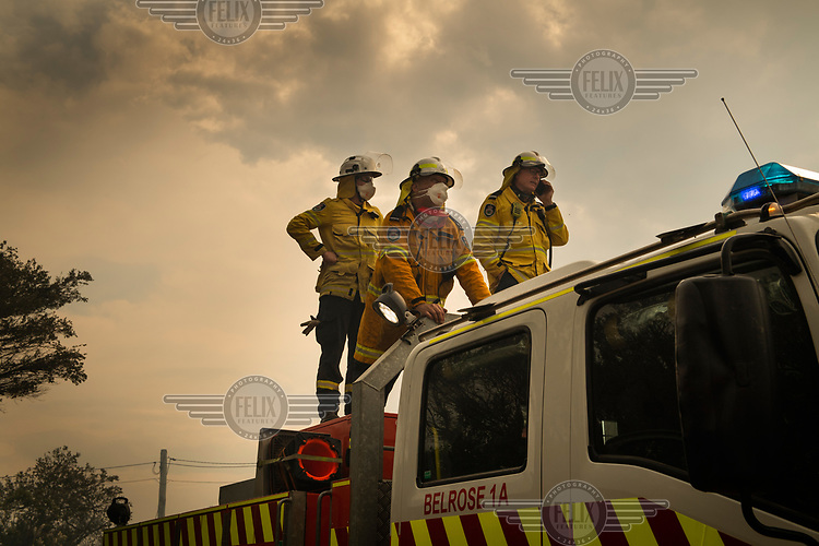 Fire service personnel stand on the top of one of their vehicles as they try and deal with a serious fire that burnt much of Sydney's North Head. The fire spread after a NSW National Parks hazard reduction burn jumped containment lines and quickly got out of control forcing the evacuation of nearby residents and the destruction of 90 hectares of bushland. Increasingly, as science continues to inform us that climate change is having an enormous impact on the frequency and intensity of weather related events, the windows for optimal hazard reduction burn conditions are becoming smaller.