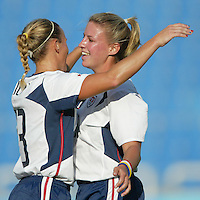 17 August 2004:  Kristine Lilly celebrates with Aly Wagner after Lilly scored a goal during the first half of the game against Australia at Kaftanzoglio Stadium in Thessaloniki, Greece.     USA defeated Australia, 0-0.   Credit: Michael Pimentel / ISI