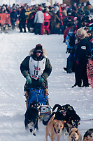Ray Redington Jr. team leaves the start line during the restart day of Iditarod 2009 in Willow, Alaska