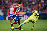 Angel Correa (L) of Atletico de Madrid fights for the ball with Sergio Mora Sanchez of Getafe CF during the La Liga 2017-18 match between Atletico de Madrid and Getafe CF at Wanda Metropolitano on January 06 2018 in Madrid, Spain. Photo by Diego Gonzalez / Power Sport Images