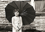 Williamsport, Pa, 1968. Young girl with umbrella.