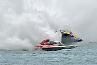 """Frame 25: Brandon Kennedy, GP-25 """"EMS Survivor"""" and Martin Rochon, GP-77 """"Coppertone Sport"""" race into the Roostertail Turn where the GP-25 hooks to the left and the GP-77 hits and catapults over.   (Grand Prix Hydroplane(s)"""