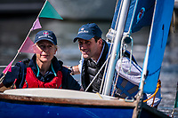 BNPS.co.uk (01202 558833)<br /> Pic: MaxWillcock/BNPS<br /> <br /> Pictured: Sir Ben Ainslie and The Honourable Mary Montagu-Scott arrive at the celebration sailing a scow.<br /> <br /> Britain's most decorated Olympic sailor Sir Ben Ainslie is the guest of honour at a celebration for the 50th anniversary and completion of the £2m redevelopment of Buckler's Hard Yacht Harbour in Beaulieu, Hampshire.