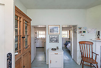 BNPS.co.uk (01202 558833)<br /> Pic: RichardDowner/TheCoastalHouse/BNPS<br /> <br /> Pictured: Inside the house.<br /> <br /> An off-grid beachside 'oasis' that has no mains water or electricity is on the market for £550,000.<br /> <br /> The former coastguard cottage is the ultimate retreat for those looking to get away from the modern world - with an outside toilet, 'gravity' shower and no wi-fi.<br /> <br /> It is one of three cottages, built by Napoleonic prisoners of war, above the remote National Trust-owned Mansands Beach, between Kingswear and Brixham in Devon.<br /> <br /> The two-bedroom cottage has spectacular panoramic views of the sea and the South Devon coastline and the three properties also share access to a private cove below.