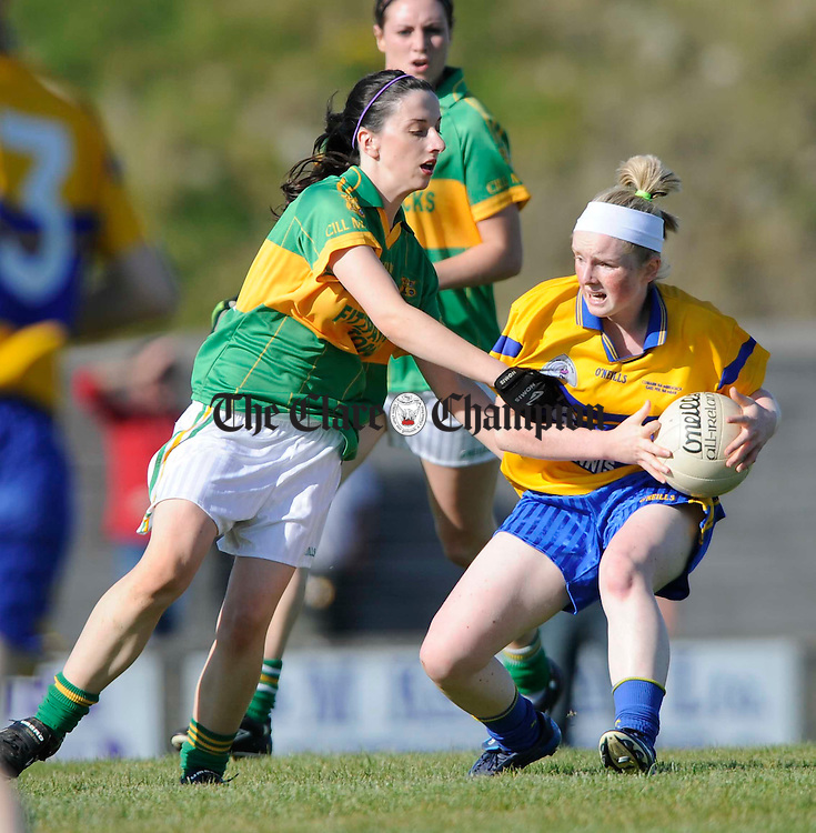 The Banner's Naoimi Carroll is tackled by Kilmihil's Miriam Frawley during their Ladies Senior championship A final at Kilmihil. Photograph by John Kelly.