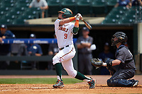 Carl Chester (9) of the Miami Hurricanes follows through on his swing against the Georgia Tech Yellow Jackets during game one of the 2017 ACC Baseball Championship at Louisville Slugger Field on May 23, 2017 in Louisville, Kentucky. The Hurricanes walked-off the Yellow Jackets 6-5 in 13 innings. (Brian Westerholt/Four Seam Images)