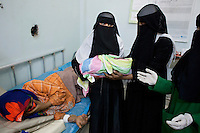 Students at the Health Science Institute in Houdeidah attend to a mother who has recently given birth. Many of the young women at this college come from the surrounding countryside and the plan is that they will return to work in their villages where there is one midwife for every 8,000 people.  ..