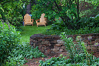 Adirondack chairs on lawn in secret garden woodland clearing behind stone wall; Sustainable Sites Initiative™ (SITES™);  Taylor Residence