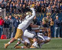 The Notre Dame defense sacks Pitt quarterback Nate Peterman. The Notre Dame Fighting Irish football team defeated the Pitt Panthers 42-30 on Saturday, November 7, 2015 at Heinz Field, Pittsburgh, Pennsylvania.
