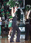 The North Texas Mean Green dance team performs during the NCAA Women's basketball game between the Arkansas State Red Wolves and the University of North Texas Mean Green at the North Texas Coliseum,the Super Pit, in Denton, Texas. Arkansas State defeated UNT 62 to 59
