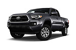 Stock pictures of low aggressive front three quarter view of a 2016 Toyota Tacoma SR5 Access Cab 4 Door Pick Up