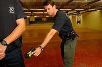 2001 File Photo, Montreal, Quebec, Canada; <br /> <br /> A Quebec provincial police (Surete du Quebec) officer demonstrate a electric stunt gun at the Police firing range in Montreal<br /> <br /> (Mandatory Credit: Photo by Sevy - Images Distribution (©) Copyright 2002 by Sevy<br /> <br /> NOTE :  D-1 H original JPEG, saved as Adobe 1998 RGB.<br />  Uncompressed and uncropped original  size file available on request.