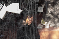 Die Rauminstallation LOST WORDS der 45jaehrigen japanischen Kuenstlerin Chiharu Shiota im Inneren der Berliner Nikolaikirche.<br /> Im Kirchenschiff wurde ein dichtes Gespinst aus ueber 750 Kilometern schwarzen Faeden, mit 4.000 Bibelseiten verschiedener Zeiten und Uebersetzungen sowie ueber 100 Sprachen eingewoben sind. Es steht fuer die Kuenstlerin als ein Sinnbild fuer die globale Verflochtenheit der Reformation und der biblischen Botschaft. Vor dem Hintergrund der Geschichte ihrer Japanischen Heimat verbindet Shiota in der Installation die aktuellen Debatten um Migration und Integration mit der Frage nach dem der Verbreitung der biblischen Schriften, die ihrerseits Teil unseres kulturellen Gedaechtnisses innerhalb einer weltweiten Migrations- und Integrationsgeschichte sind.<br /> Das Kunstwerk ist vom 29. September bis 19. November 2017 in der Nikolaikirche zu sehen.<br /> Im Bild: die Kuenstlerin Chiharu Shiota.<br /> 28.9.2017, Berlin<br /> Copyright: Christian-Ditsch.de<br /> [Inhaltsveraendernde Manipulation des Fotos nur nach ausdruecklicher Genehmigung des Fotografen. Vereinbarungen ueber Abtretung von Persoenlichkeitsrechten/Model Release der abgebildeten Person/Personen liegen nicht vor. NO MODEL RELEASE! Nur fuer Redaktionelle Zwecke. Don't publish without copyright Christian-Ditsch.de, Veroeffentlichung nur mit Fotografennennung, sowie gegen Honorar, MwSt. und Beleg. Konto: I N G - D i B a, IBAN DE58500105175400192269, BIC INGDDEFFXXX, Kontakt: post@christian-ditsch.de<br /> Bei der Bearbeitung der Dateiinformationen darf die Urheberkennzeichnung in den EXIF- und  IPTC-Daten nicht entfernt werden, diese sind in digitalen Medien nach §95c UrhG rechtlich geschuetzt. Der Urhebervermerk wird gemaess §13 UrhG verlangt.]