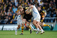 Joe Launchbury of London Wasps is tackled by Hoani Tui of Exeter Chiefs during the Aviva Premiership match between London Wasps and Exeter Chiefs at Adams Park on Sunday 21st April 2013 (Photo by Rob Munro)