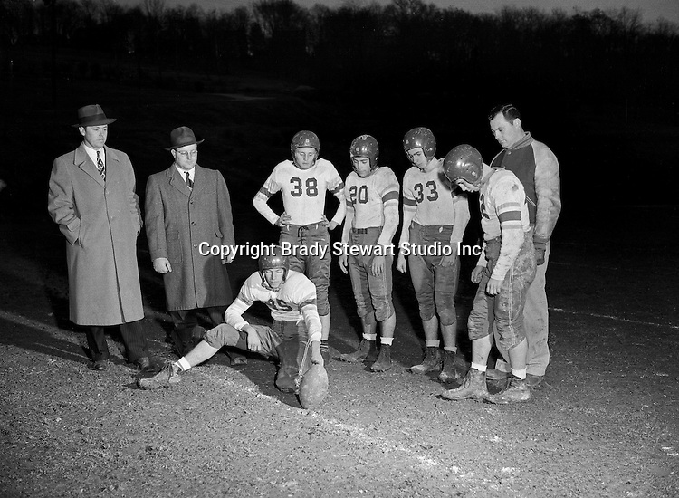 Mount Lebanon PA:  The Mount Lebanon Wildcats football team practicing behind the High School. Big Jim Daniell was coaching the team. Big Jim played college football at Ohio State and professional football for the Chicago Bears and Cleveland Browns.