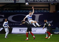 17th February 2021; The Kiyan Prince Foundation Stadium, London, England; English Football League Championship Football, Queen Park Rangers versus Brentford; Rob Dickie of Queens Park Rangers heads the ball above Mathias Jensen of Brentford