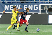 FOXBOROUGH, MA - OCTOBER 3: Scott Caldwell #6 of New England Revolution brings the ball forward as Hany Mukhtar #10 of Nashville SC defends during a game between Nashville SC and New England Revolution at Gillette Stadium on October 3, 2020 in Foxborough, Massachusetts.