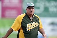 Beloit Snappers pitching coach Craig Lefferts (39) walks back to the dugout after a mound visit during a game against the Clinton LumberKings on August 17, 2014 at Ashford University Field in Clinton, Iowa.  Clinton defeated Beloit 4-3.  (Mike Janes/Four Seam Images)