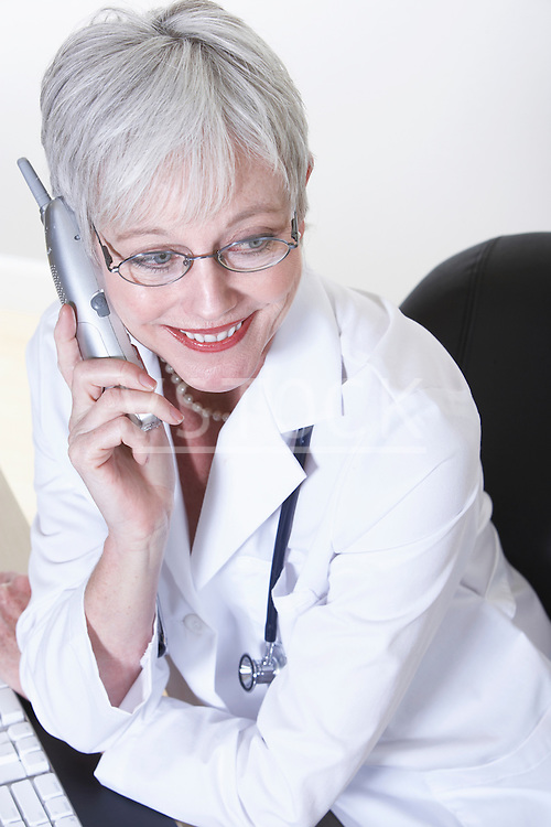 USA, California, Fairfax, Female doctor talking on phone at desk
