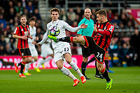 BOURNEMOUTH, ENGLAND - MARCH 18:Tom Carroll of Swansea City looks on as Ryan Fraser of Bournemouth  kicks the ball away during the Premier League match between AFC Bournemouth and Swansea City  at Vitality Stadium, Bournemouth, England, UK. Saturday 18 March 2017