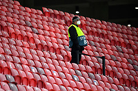 16th February 2021, Puskas Arena, Budapest, Hungary; Champions League football, FC Leipig versus Liverpool FC;   A steward stands in the otherwise empty stands.
