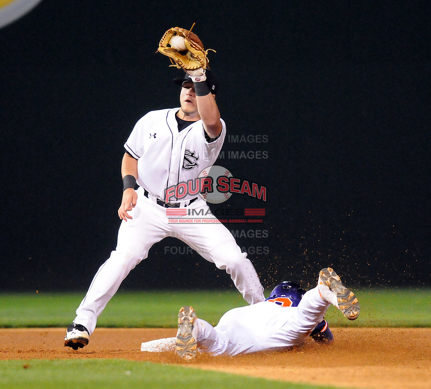 Shortstop Brad Miller (13) of the Clemson Tigers steals second base in the first inning of a game against the South Carolina Gamecocks on Tuesday, March 8, 2011, at Fluor Field in Greenville, S.C.  Defending is second baseman Jake Watson (20) of South Carolina.  Photo by Tom Priddy / Four Seam Images