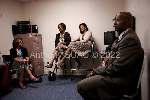 Denver, Colorado<br /> August 26, 2008<br /> <br /> Michelle Obama backstage at the Sheraton Hotel in downtown Denver between speeches at the LGBT delegates luncheon and Emily's List Gala reception in the hotel.