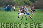 Dromids Shane O'Connor gets the kick away before the challenge of St Marys Aidan Walsh.