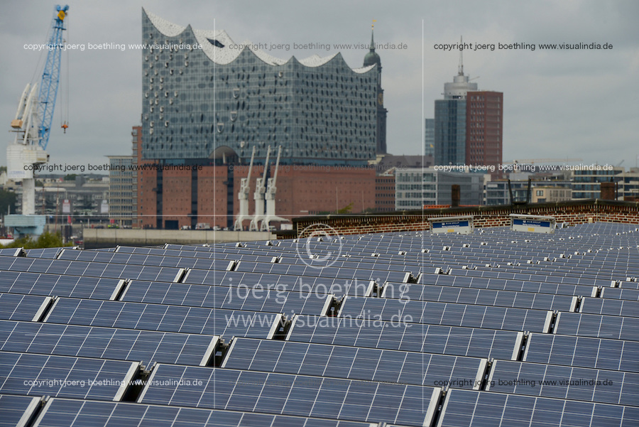 GERMANY, Hamburg, concert hall Elbphilharmonie and solar panel on roof of store-house in harbour / DEUTSCHLAND, Hamburg, Konzerthaus Elbphilharmonie und Solarmodule des staedtischen Energieversorger Hamburg Energie auf einem Kaischuppen im Hafen