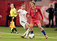 CARSON, CA - FEBRUARY 7: Jimena Lopez #5 of Mexico and Tobin Heath #17 of United States fight for a loose ball during a game between Mexico and USWNT at Dignity Health Sports Park on February 7, 2020 in Carson, California.