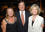 From left: Jan Scott with Joe and Deanna Kienast at the grand opening of the Valentino restaurant at the Hotel Derek Thursday Oct. 15,2009. (Dave Rossman/For the Chronicle)