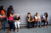 Young Filipinos seen waiting for audition outside the Glorietta mall in the city of Makati in the Philippines. Photo: Sanjit Das