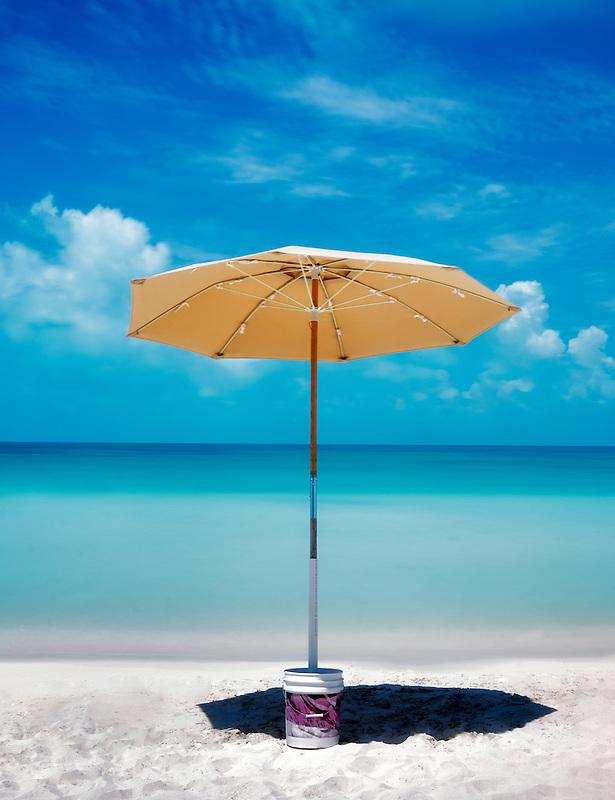 Sappodilla Bay with umbrella. P{rovidenciales, Turks and caicos
