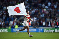 Amanaki Mafi of Japan celebrates the win after the final whistle. Rugby World Cup Pool B match between South Africa and Japan on September 19, 2015 at the Brighton Community Stadium in Brighton, England. Photo by: Patrick Khachfe / Stewart Communications
