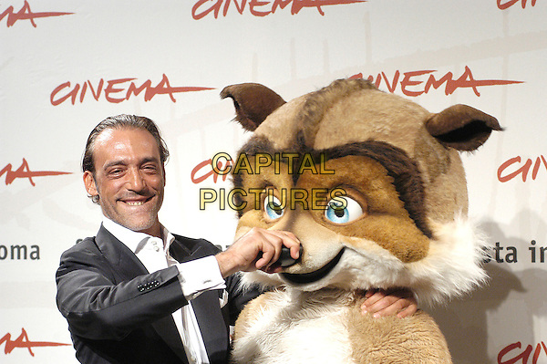 "LUCA WARD.attends a photocall to promote the movie ""La Gand De Bosco"" on the eighth day of Rome Film Festival (Festa Internazionale di Roma) in Rome, Italy, October 20th 2006..half length funny animal character costume hand on over nose.Ref: CAV.www.capitalpictures.com.sales@capitalpictures.com.©Luca Cavallari/Capital Pictures."