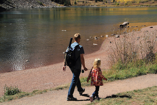 Caucasian father with daughter fly-fishing at Maroon Lake, Maroon Bells-Snowmass Wilderness Area, Aspen, Colorado, USA