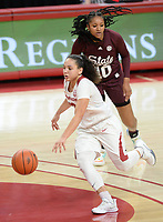Arkansas guard Destiny Slocum (center) drives Thursday, Feb. 11, 2021, past Mississippi State forward Sidney Cooks (10) during the first half of play in Bud Walton Arena. Visit nwaonline.com/210212Daily/ for today's photo gallery. <br /> (NWA Democrat-Gazette/Andy Shupe)