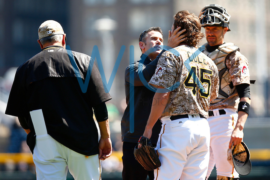 Gerrit Cole #45 of the Pittsburgh Pirates is checked on at the mound after taking a hit from a come backer against the Detroit Tigers during the game at PNC Park in Pittsburgh, Pennsylvania on April 14, 2016. (Photo by Jared Wickerham / DKPS)