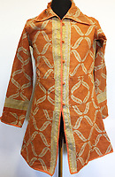 BNPS.co.uk (01202 558833)<br /> Pic: Omega/BNPS<br /> <br /> Also included is the orange jacket George took on his trip to India and left behind.<br /> <br /> Never before seen photographs of George Harrison's spiritual trip to India that influenced the rest of The Beatles to later visit have been unearthed over 50 years later.<br /> <br /> The late Beatle found the 1966 pilgrimage to the sub-continent liberating and persuaded the rest of the band to go back with him 18 months later.<br /> <br /> Their famous visit and stay with the Maharishi Mahesh Yogi's yoga retreat had a significant influence in the music the Fab Four went on to  produce.<br /> <br /> The six colour faded photos show George with his wife Patti Boyd with sitar player Ravi Shankar and friends sitting among ancient ruins and a selfie of him on a beach.<br /> <br /> Being sold alongside the snaps is a quilted orange jacket that George wore in India and left behind in 1967.