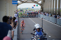 With 1 more local lap to go, the last surviving escapee Giacomo Berlato (ITA/Nippo-Vini Fantini) is caught by the chasing peloton on the bridge before the finish zone<br /> <br /> stage 2: Arnhem-Nijmegen (NLD) 190km<br /> 99th Giro d'Italia 2016